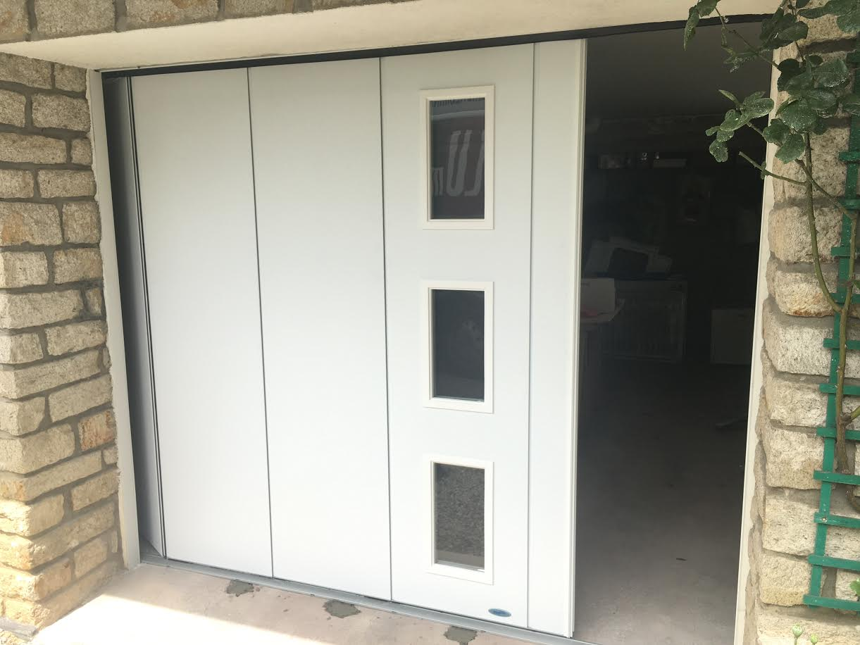 Porte de garage lat rale r alis e brech aluminium56 for Porte de garage 06